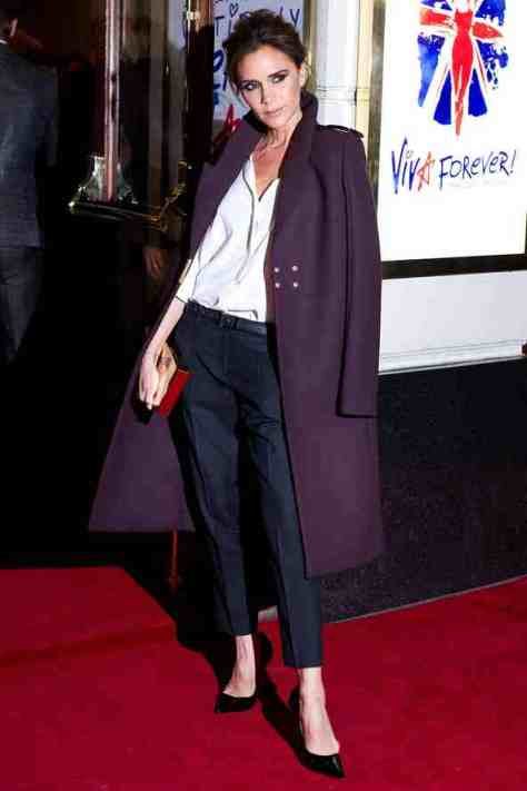 Victoria Beckham in a long military wool coat