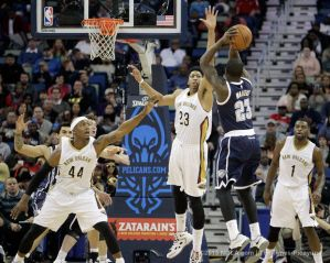 Anthony Davis trying to block a shot
