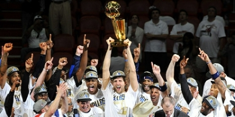 Lone Star Dirk Nowitzki hoisting the Championship trophy with the Mavs