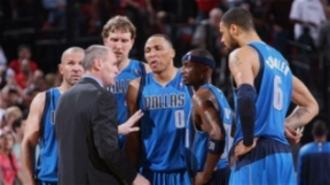 Mavs and Coach Rick Carlisle in a huddle