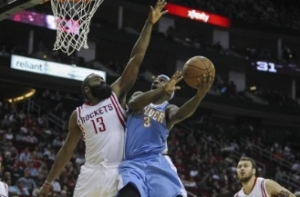 Ty Lawson drives against James Harden, now his backcourt partner