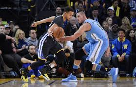 Curry against Danilo Gallinari